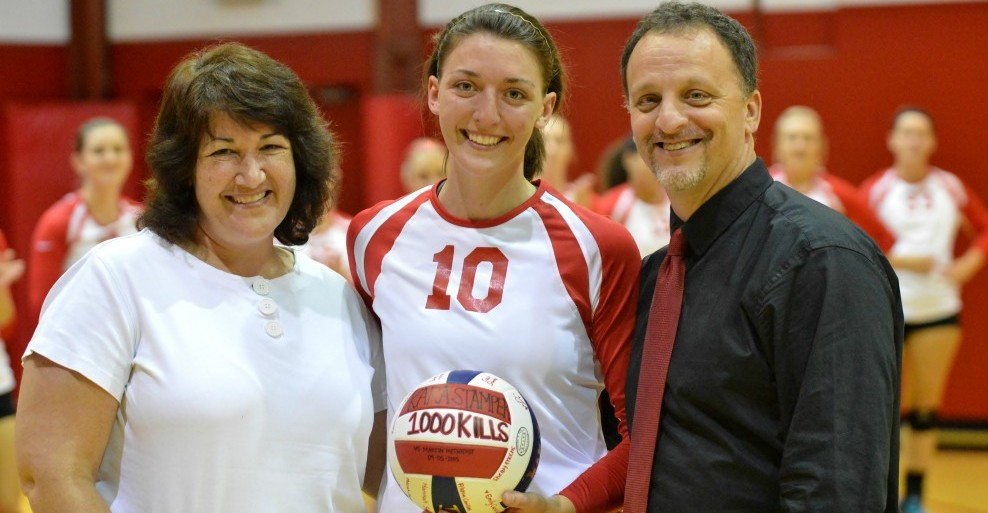 (photo by Michael Lindsay) Pictured with Kara is her mother Karen Stamper and Head Volleyball Coach Dave Shumaker