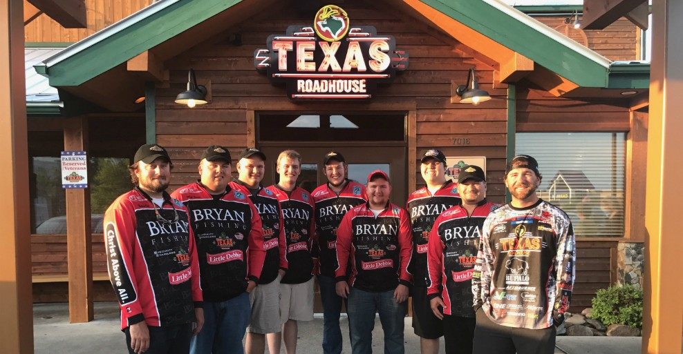 Pictured are some of the Bryan Lions alongside pro angler John Hunter (right) at sponsor Texas Roadhouse